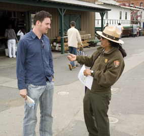 Park Ranger Rubén Guzmán with a visitor on Hyde Street Pier.