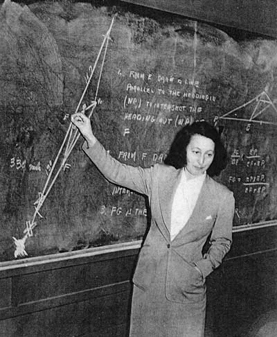 A woman standing in front of a chalkboard.