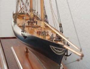 A closeup of a scale model of the yacht AMERICA.