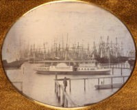 This quarter plate daguerreotype is of the riverboat Erastus Corning with the owner Charles Minturn standing in the foreground, San Francisco, Calif., circa October 1850. The photograph is attributed to the daguerreotypist Frederick Combs. (P81-010.1cps)