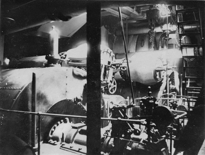 Interior view of a steam ship engine room.