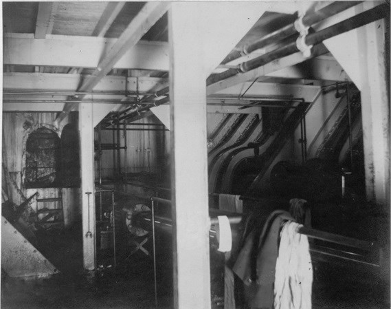 The dark, oily interior of a steamship.