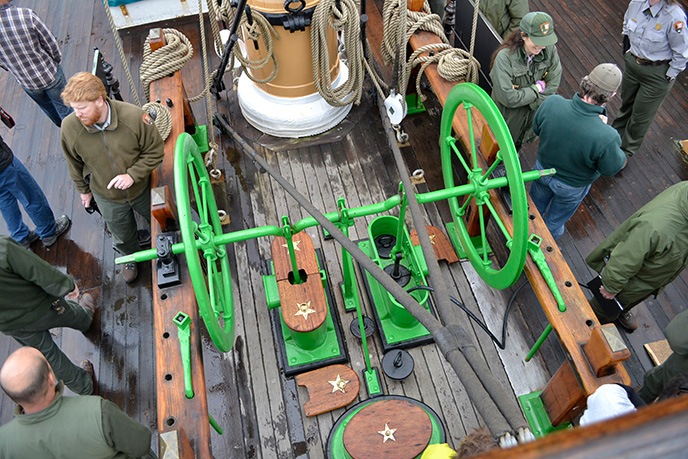 A photograph looking down on the bilge pump on the main deck of a sailing ship.