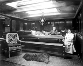 Captain and Mrs. Harrison in their cabin aboard the British ship Eva Montgomery, at Puget Sound, WA, ca. 1904 (Wilhelm Hester Collection).