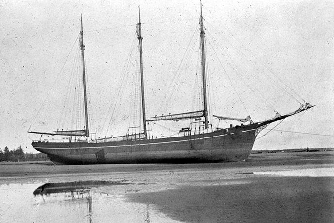 A wooden sailing vessel with three masts. SAFR E3.8495n