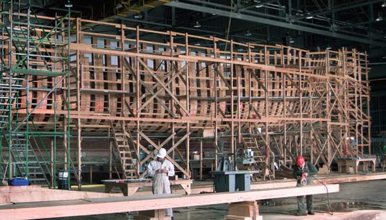 The ship's hull, with the rotten frames removed and covered with scaffolding.