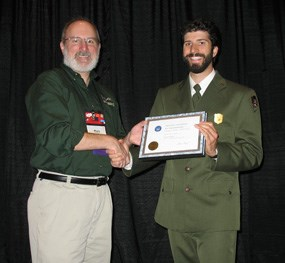 Park Ranger Chris Poissant accepting the award for the park.
