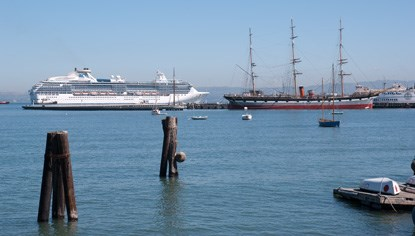 A modern-day cruise ship passing BALCLUTHA moored at Hyde Street Pier.