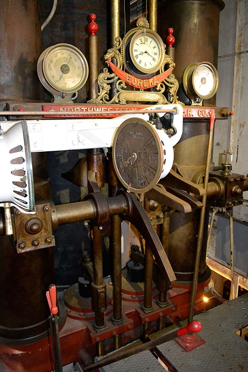 Various dials and levers used to control a ferryboat engine.