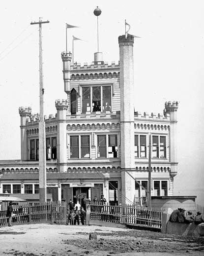 A historic photo of an elaborate structure that has several turrets.