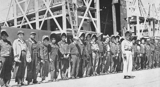 A gang of welders at the Marinship yard around 1943. The woman in front is Kay Daws. Daws was a former buyer in a dress shop who became a foreman.
