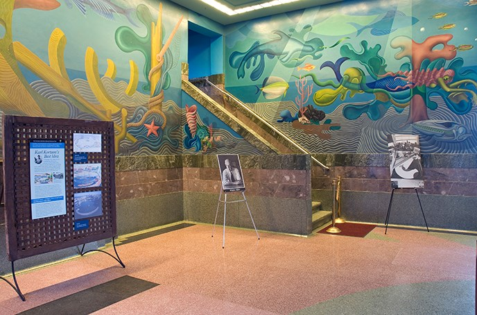 A corner section of a colorful mural on the walls of the Bathhouse lobby.