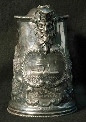 A front view of a silver pitcher.
