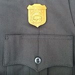 NPS uniform pocket with gold badge