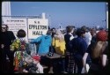 Spectators gather around signs to welcome the Eppleton Hall crew to San Francisco at Fisherman's Wharf.