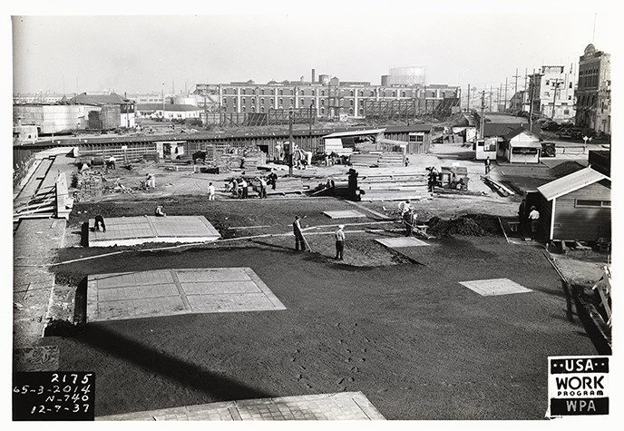 A black and white photo taken in 1937 of the area just east of the Bathhouse building.