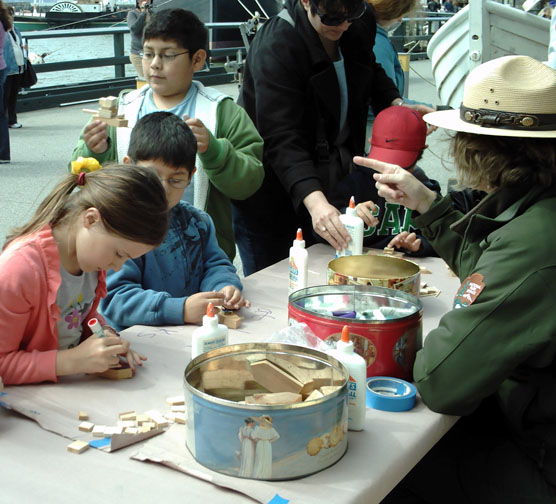 Children at a table doing crafts.