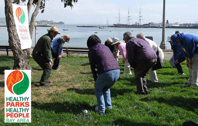People exercising gently near Aquatic Park cove.