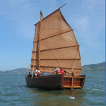 A replica of a Chinese shrimp junk sailing on San Francisco Bay.