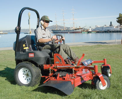 The park's new red-colored ride-on mower runs on B100, a 100% vegetable-based diesel fuel.