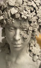 Sculpted Head with flowers for hair done in clay