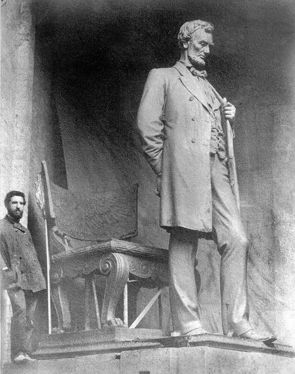 "Augustus Saint-Gaudens with the full-size clay model of the ""Standing Lincoln"", in his studio, Cornish, N.H. 1886."