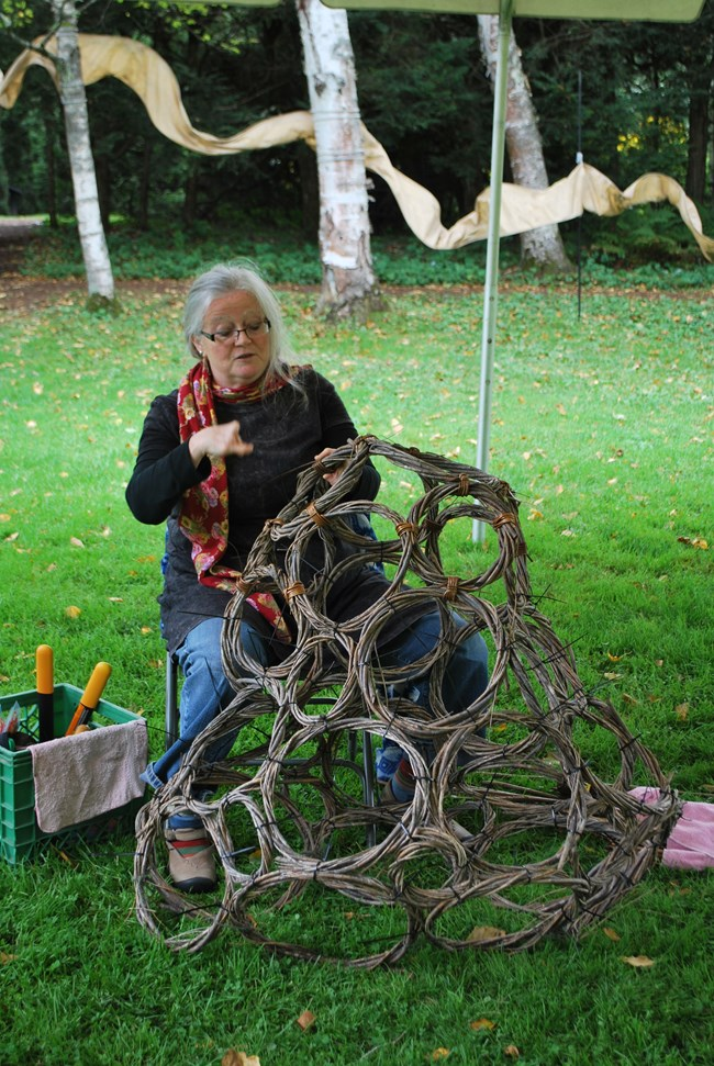 Susie Gray using willow shoots to create sculpture NPS Photo