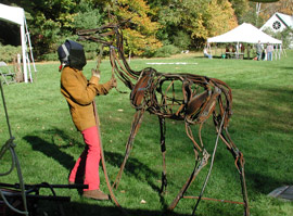 Sculptor, Wendy Klemperer, welding an iron sculpture of a deer during the Sculptural Visions event in 2006