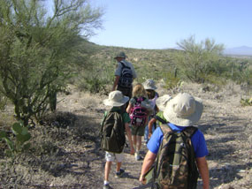 Junior Rangers hike the Freeman Homestead Trail at Saguaro National Park's east district