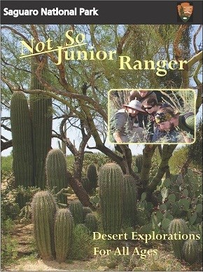 "Image of booklet with many young saguaros, inset photo of people looking at a plant, and text reading ""Not So Junior Ranger.  Desert Explorations For All Ages"""