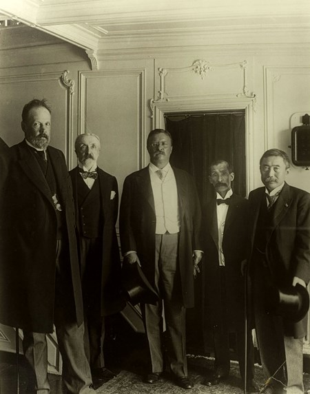 Theodore Roosevelt with dignitaries after the creation of the Russo-Japanese Peace Treaty.