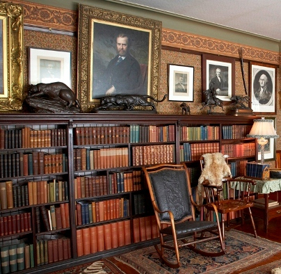 A collection of books in the library at the Theodore Roosevelt Home.