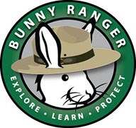 "A logo of a bunny wearing a park ranger flat hat encircled by the text ""Bunny Ranger, Explore, Learn, Protect"