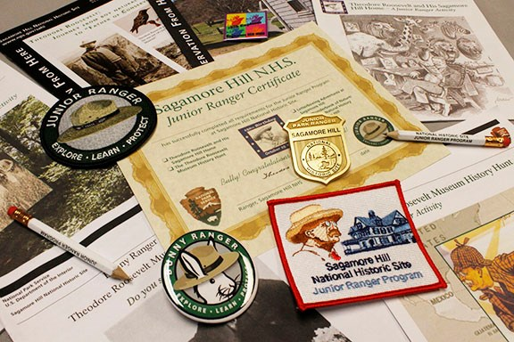 A variety of Junior Ranger booklets, badges, and patches from Sagamore Hill.