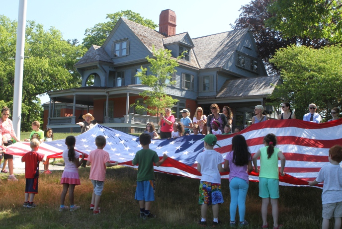 Fourth grade students practice U.S. flag etiquette with the help of National Park Service Rangers at Sagamore Hill National Historic Site in New York. Sagamore Hill, at Oyster Bay, was the home of Theodore Roosevelt and his family. National Park Service Photo