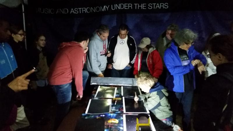 Visitors, astronomers, and park rangers exploring the night sky. NPS Photo