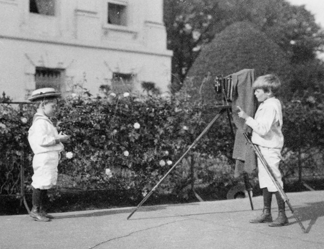 Archie takes photo of Quentin, 1902