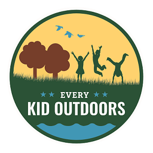 "Yellow circular logo with silhouetted children playing in a natural space with the words ""Every Kid Outdoors"" printing underneath."