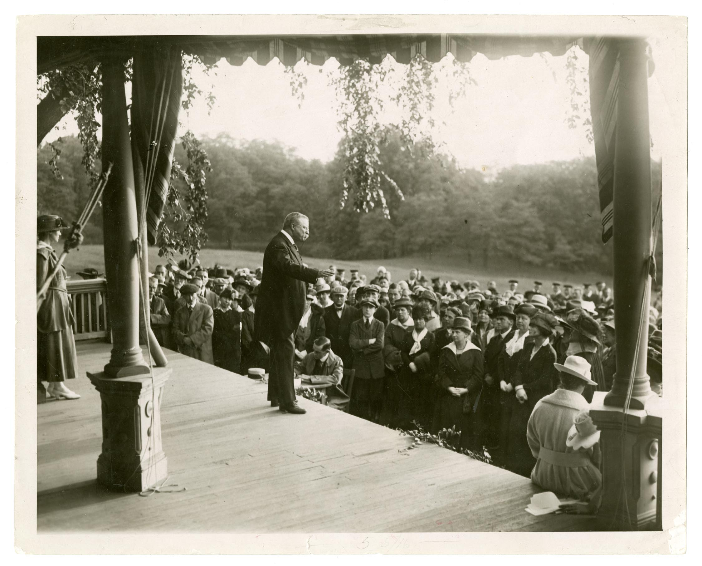 Theodore Roosevelt addresses a crowd of suffrage delegates from the porch of his home at Sagamore Hill in 1917. NPS Photo