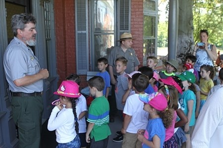 Students listening to a ranger on the porch of Sagamore Hill.
