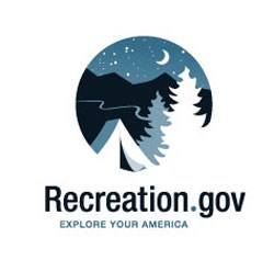 "Logo with a tent, pine trees, and mountains under a night sky with the text, ""Recreation.gov: Explore Your America"""