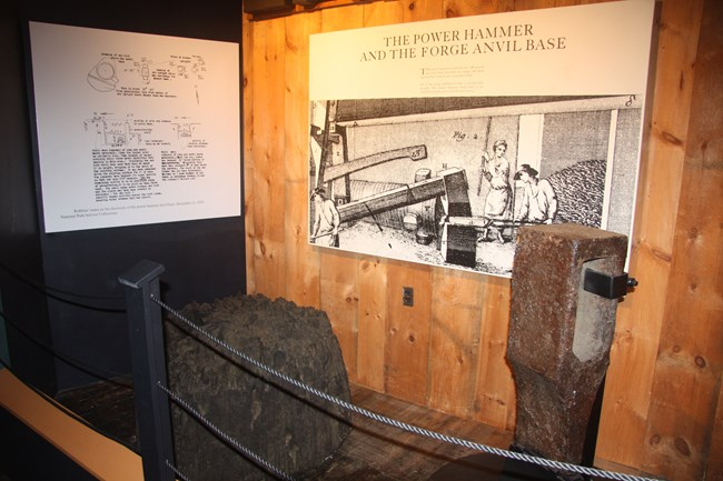 A display within the museum showing an anvil base and hammer head.