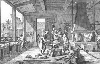 Three iron workers in a forge hammer iron on an anvil. A hearth is tended by a worker against wall behind them. Another worker organizes tools near window at left.
