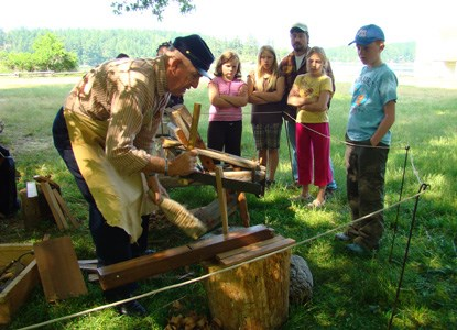 Gordon Smith demonstrates wood working tools for visitors.