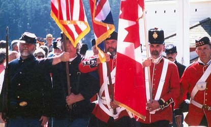 The precursor of Battery D Foundation color guard marches from during the first Encampment in 1998.