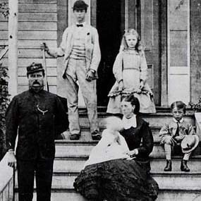 Capt. William Addis Delacombe and his family on the front steps of their house at the Royal Marine Camp.