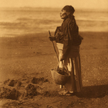 woman on beach with stick