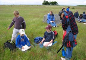 School children learn about prairie habitat on a field trip to the park.