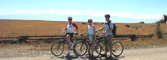 Cyclists pause to enjoy the view on the Redoubt Road at American Camp