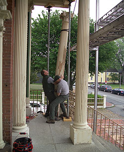 Salem Maritime staff removing a column from the Salem Custom House portico for repair.